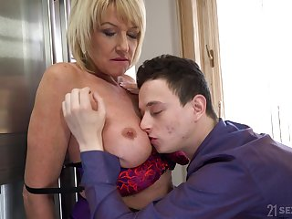 Mature blonde Milf Amy enjoys a younger dick and a cumshot in mouth