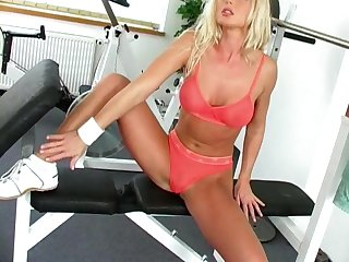 Sporty MILF in underwear Silvia Saint strips and masturbates at a gym