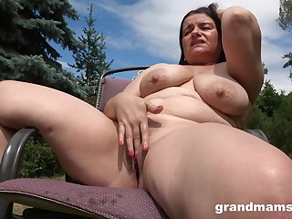 Horny milf masturbates in the garden approximation about indestructible penis